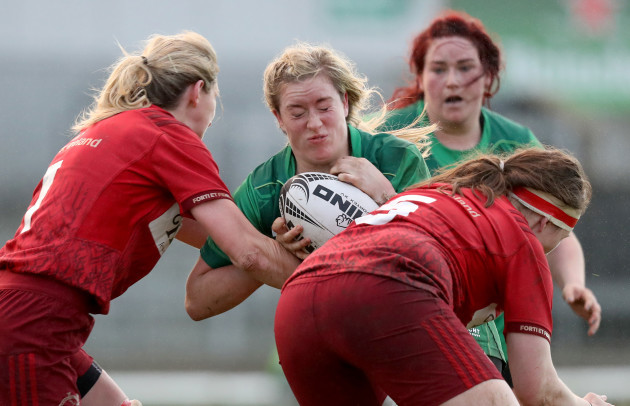 Chloe Pearse and Siobhan Fleming tackle Edel McMahon