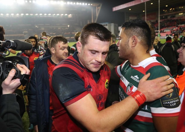 CJ Stander with LeicesterÕs Manu Tuilagi after the game