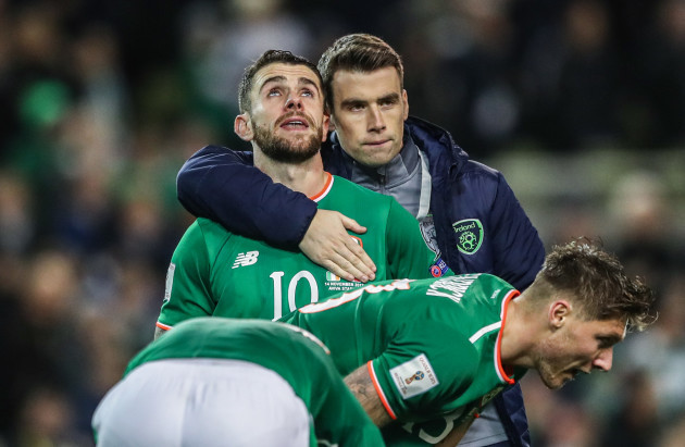 Robbie Brady and Seamus Coleman dejected after the match