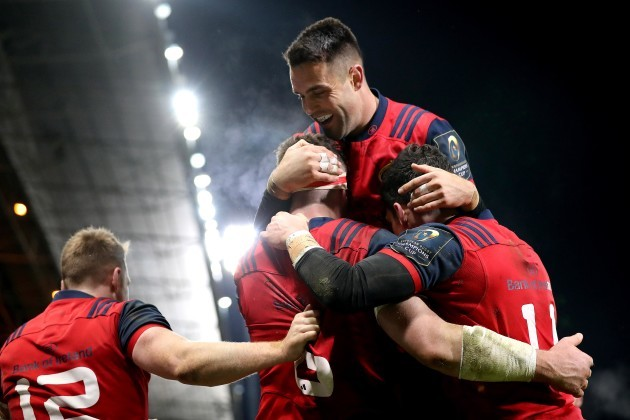 Peter O'Mahony celebrates scoring a try with Conor Murray and Alex Wootton