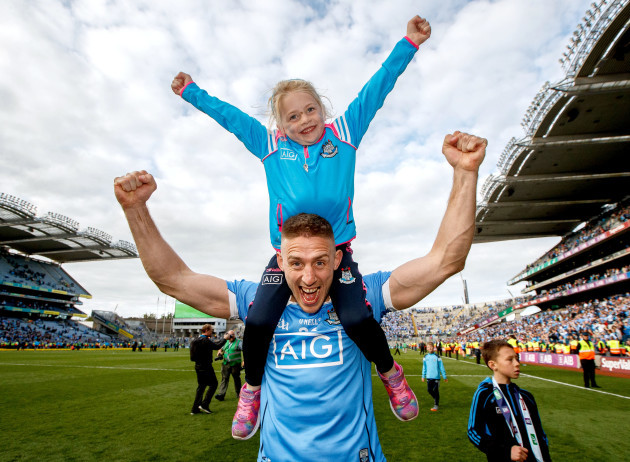 Eoghan O'Gara celebrates with his daughter Ella after the game