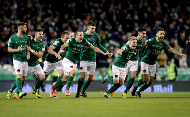 Cork City players celebrate the Kieran Sadlier kicking the winning penalty