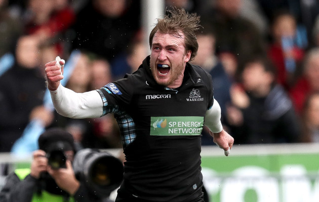 Stuart Hogg celebrates scoring his sides first try