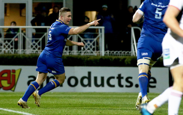 Jordan Larmour celebrates scoring a try