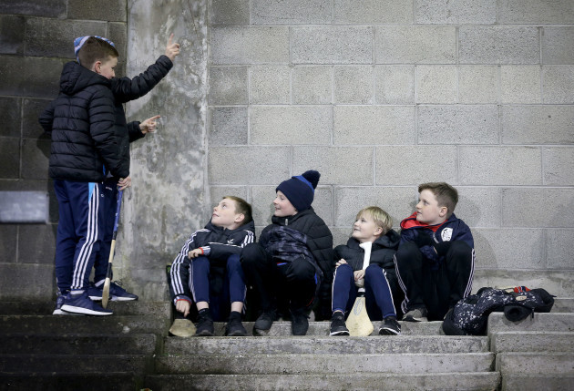 Young members of Fingalians GAA share a joke in the stands