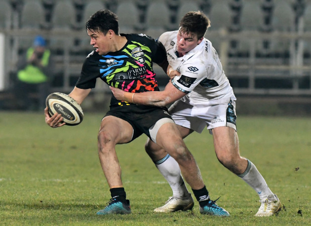 Rory Parata tackled by Huw Jones