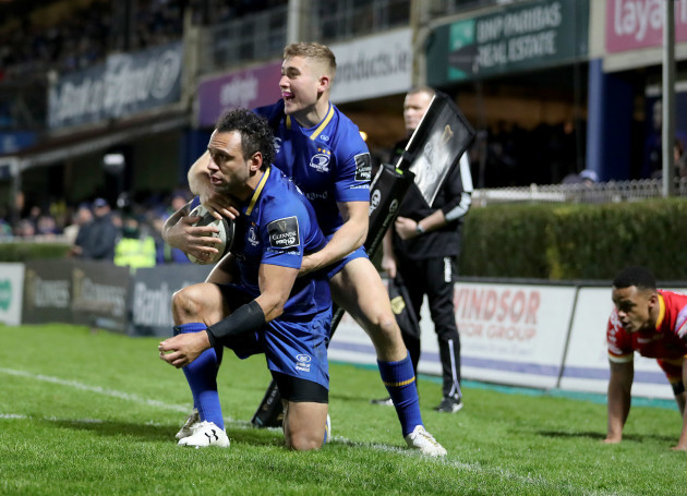 Isa Nacewa is congratulated by Jordan Larmour after scoring his sides fifth try
