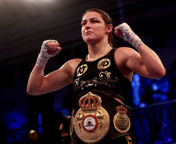 Katie Taylor celebrates after beating Jessica McCaskill