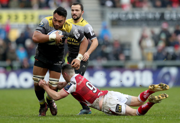 Victor Vito is tackled by John Cooney