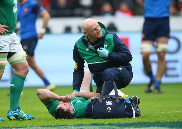 Jonathan Sexton down injured with Dr. Jim McShane