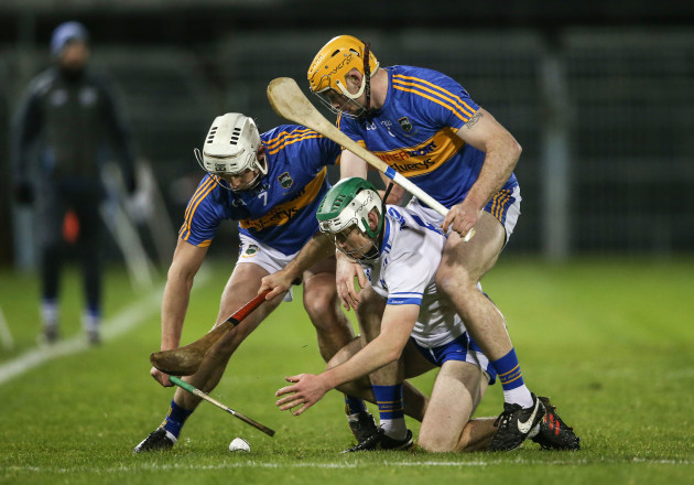 Mark O'Brien under pressure rom Padraic Maher and Ronan Maher