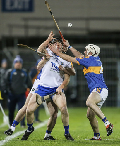 Brendan Maher and Sean O'Brien tackle Kevin Moran