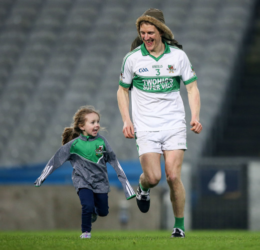John McLoughlin celebrates with his niece Caoimhe after the game