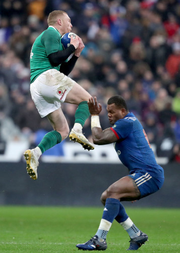 Keith Earls collects a cross field kick from Jonathan Sexton despite the efforts of Virimi Vakatawa