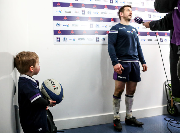 Greig Laidlaw son Ruary look on as his father is interviewed after the game