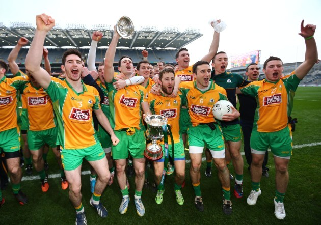 Corofin players celebrate with the cup