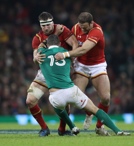 Ireland's Rob Kearney is tackled by Wales Sam Warburton and Jamie Roberts