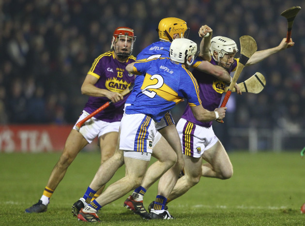 Wexford's David Dunne is tackled by Tipperary's Padraic Maher