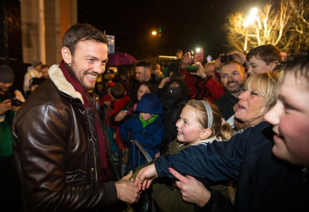 Andy Lee greets supporters