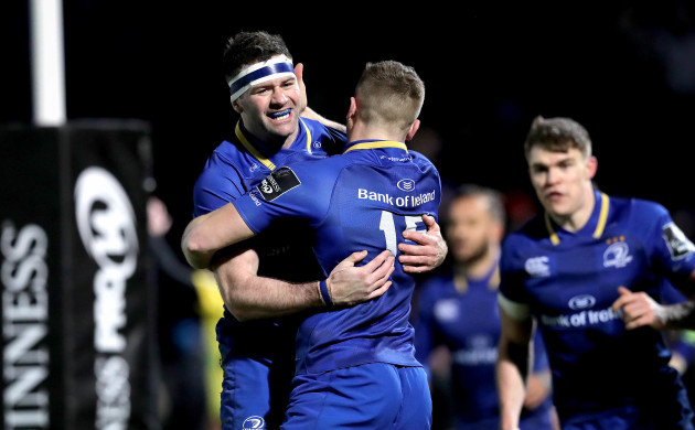 Jordan Larmour celebrates scoring the first try with Fergus McFadden