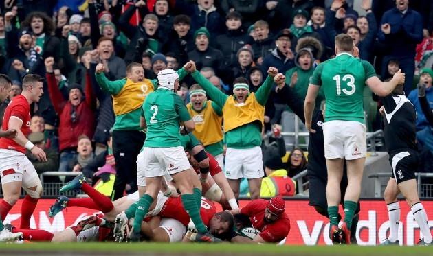 Ireland players celebrate as Bundee Aki scores their second try