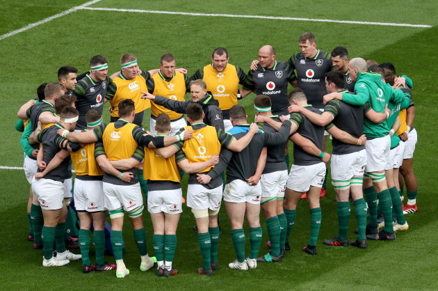 Joe Schmidt talks to his players before the game
