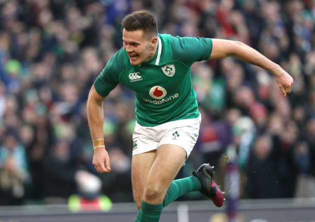 Jacob Stockdale celebrates after scoring his second try