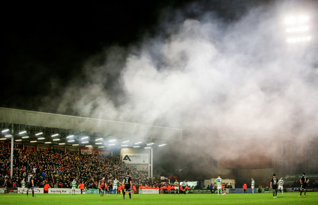 Smoke covers the pitch after fans let off flares