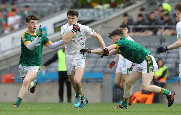 Rory O'Connor tackled by Lorcan McMonagle and Dara Moynihan
