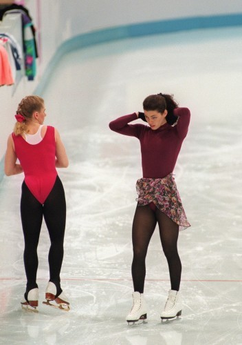 Tonya Harding (L) of the United States stands next