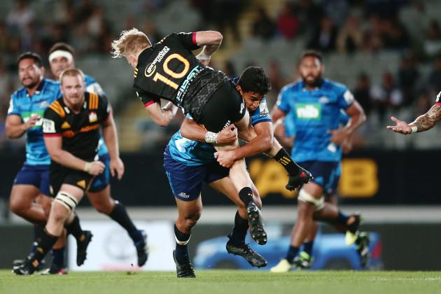 Damian McKenzie tackled by Rieko Ioane