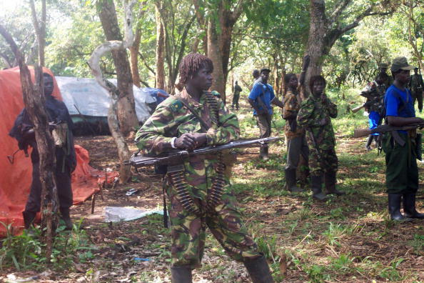 Rebel fighters of Uganda's Lord's Resistance Army gather to