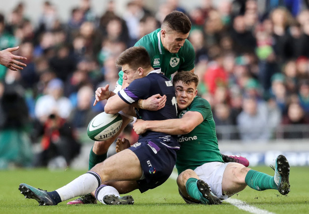 Jacob Stockdale and Garry Ringrose tackle Huw Jones