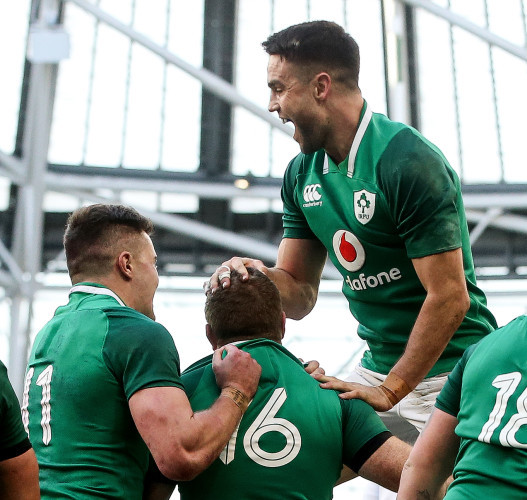 Jacob Stockdale and Conor Murray celebrate with try scorer Sean Cronin