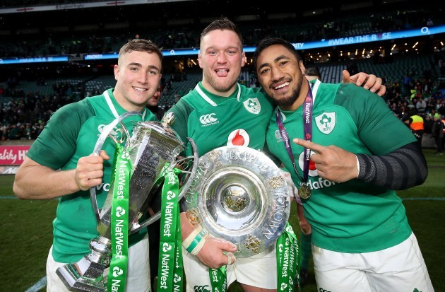 Jordan Larmour, Andrew Porter and Bundee Aki celebrate winning