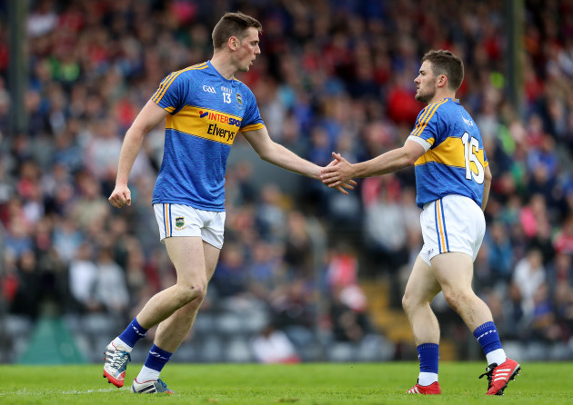 Conor Sweeney celebrates kicking a point with Liam McGrath