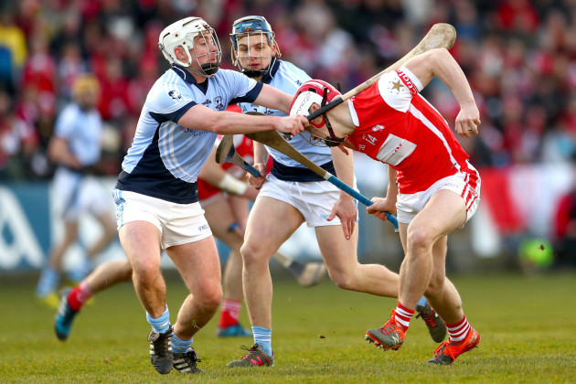Kieran Kennedy and Mike Casey tackle Con O'Callaghan