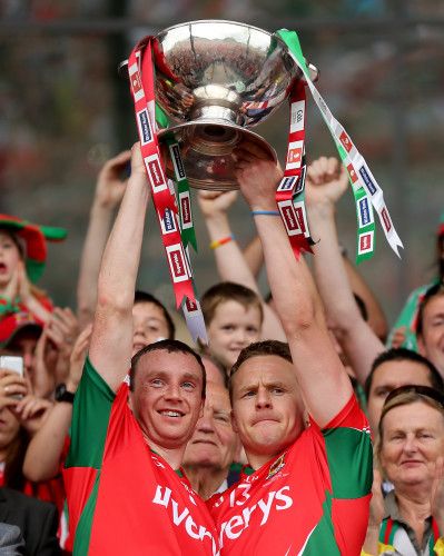 Keith Higgins and Andy Moran lifts the trophy