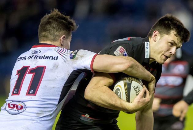 Jacob Stockdale tackles Blair Kinghorn