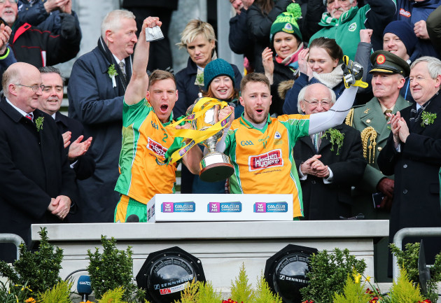 Ciaran McGrath and Micheal Lundy lift the cup