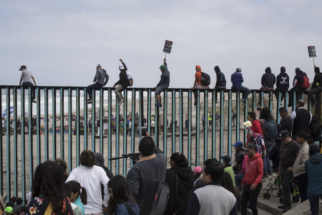 Central american migrants in stand off at us border after trump mexico migrants caravan fandeluxe Gallery