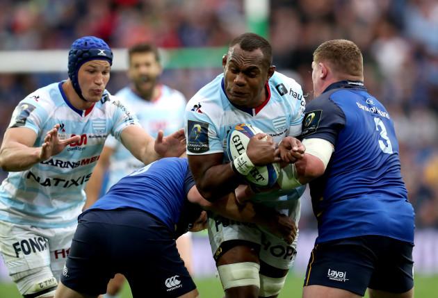 Leone Nakarawa is tackled by Jordi Murphy and Tadhg Furlong