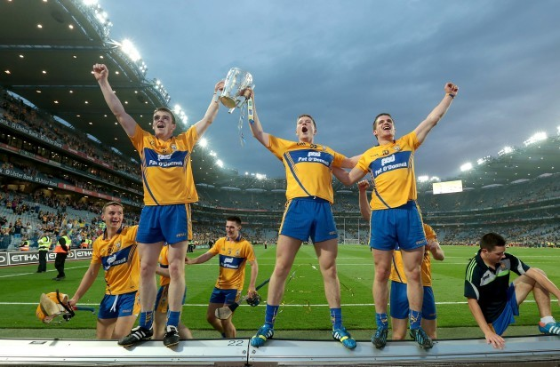 Tony Kelly, Aaron Cunningham and John Conlon celebrate with the Liam McCarthy