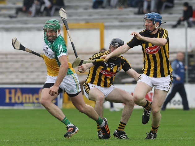 Conor Delaney and John Donnelly tackle Joe Bergin