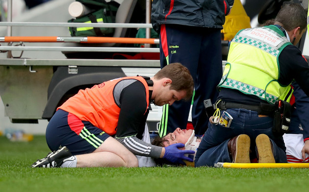 Robbie O'Flynn receives medical attention