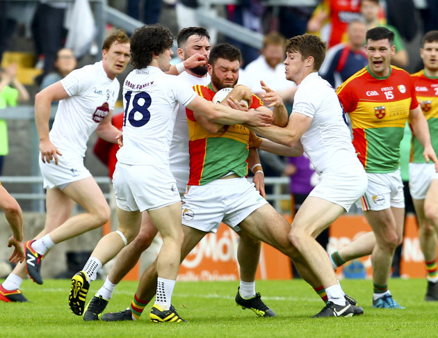 Shane Redmond is tackled by Chris Healy, Fergal Conway and Kevin Feely