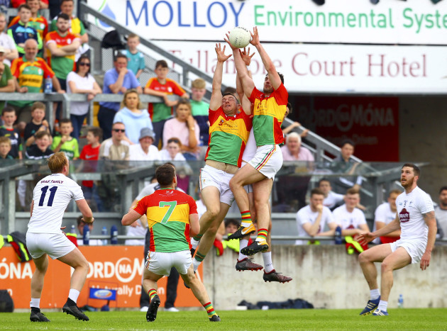 Players from Carlow and Kildare battle for possession in the air