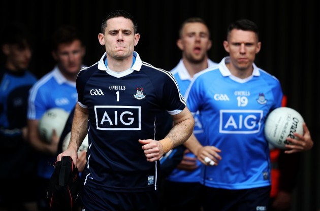 Stephen Cluxton leads out his team