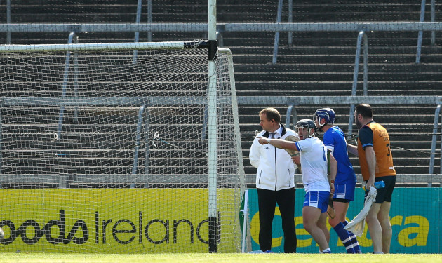 Noel Connors and goalkeeper Stephen O'Keeffe argue with the umpire after a goal was awarded