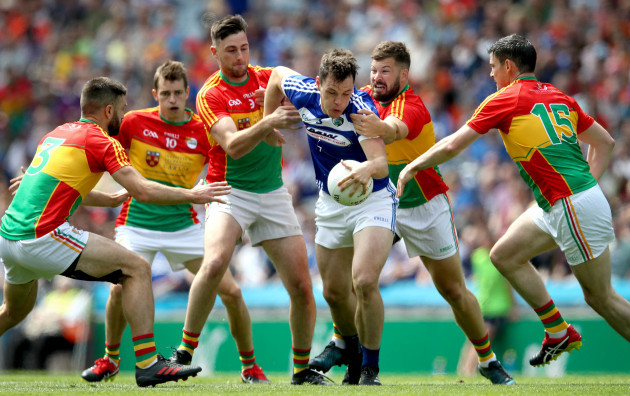 John O'Loughlin under pressure from the Carlow defence